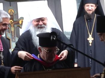 Metropolitan Tikhon awards His Grace the honorary doctorate.