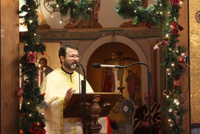Fr. Calinic offers the homily
