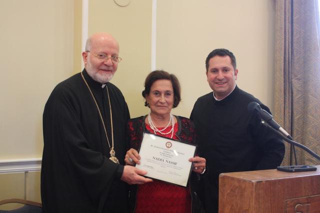 Mrs. Nadia Nassif receiving her reward