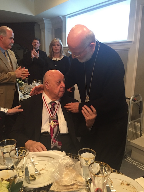 Met. Joseph awards the Order of St. Raphael of Brooklyn to Mr. Robert Laham