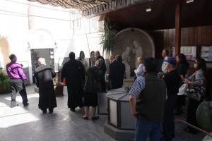 Bishop Joseph and pilgrims at St. Ananias House on Straight Street