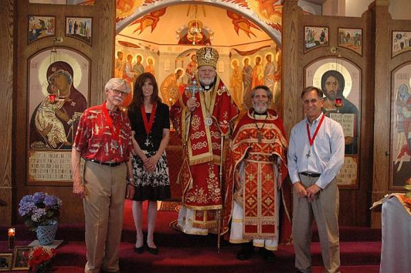 L to r: Bob Armstrong (sponsor) Teresa Vaux-Michel (new member) Bishop Joseph Fr. James Bernstein Bill Tsoukalas