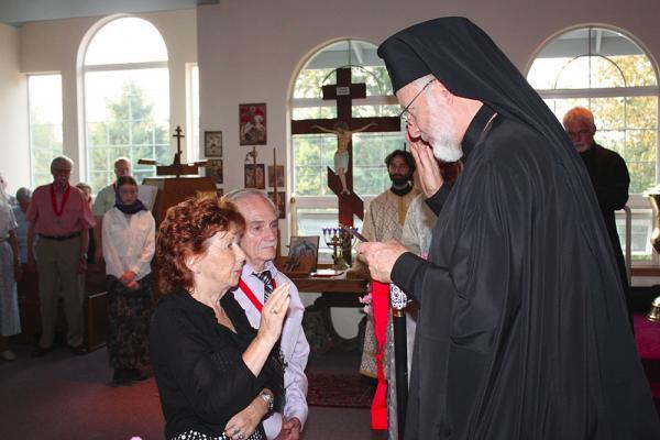L. to r.: Elle Petrakis; John Petrakis (sponsor); Fr. David Hovik; His Grace Bishop Joseph