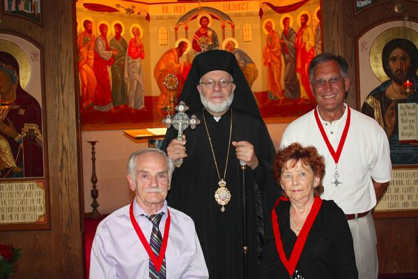 L. to r.: John Petrakis (sponsor); His Grace Bishop Joseph; Elle Petrakis; Diocesan Chair Bill Tsoukalas