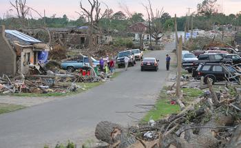 Residents of Pleasant Grove, Alabama assess damage and search for possessions scattered about after a series of tornadoes destroyed homes. (photo: George Armstrong/FEMA)