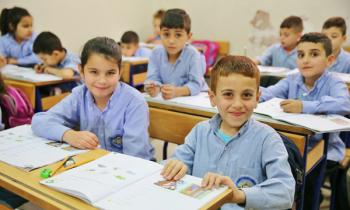 Cynthia, 9, and her classmate, David, 8, are among 128 Assyrian refugee students receiving IOCC assistance to continue their schooling in Lebanon: photo: Ramzi Haidar/IOCC