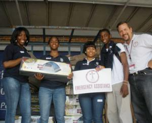 IOCC frontliner Dn. Dan Gray with volunteers in Alabama