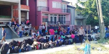 Syrian refugees gather outside of the police station in Presevo, Serbia, where they are waiting to be registered for assistance. IOCC is providing meals to the weary travelers as well as to local people in need. photo: Nenad Preleveic/IOCC