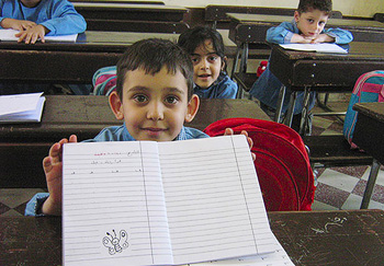 A refugee child in Syria learns to write through a program run by IOCC and the Greek Orthodox Patriarchate of Antioch.