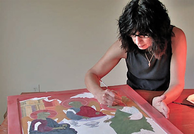 Janet Jaime working on an icon in progress.