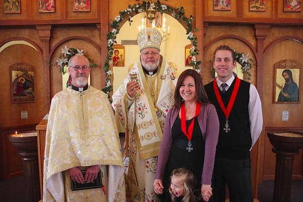 (L-R): Fr. Michael Gillis, Bishop Joseph,  Kim Franklin, Jared Neufeldt (with his daughter Lucia in front)