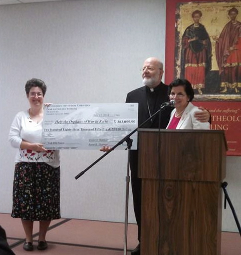 Antiochian Women present Project check to Metropolitan Joseph, July 2014