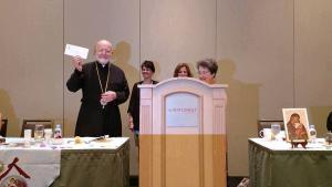 Metropolitan Joseph is presented with 2017 Project check for $116,915.37.