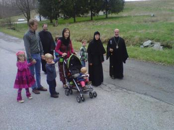 Bishop Thomas touring the property with  Sister Ignatia, Father Raphael Barberg and the Rowe Family