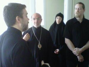 Father Patrick Cardine telling Bishop Thomas and Sister Ignatia  about his time as resident on the property