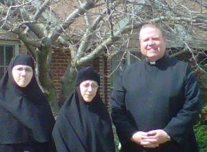 Father James Hamrick with Sister Diodora (left) and  Sister Ignitia (center) outside of the chapel