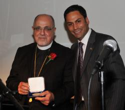 Senator David Angus presents Fr. Antony with the Diamond Jubilee Medal from Queen Elizabeth II, September 2012