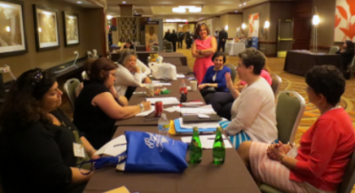 Boston, MA: Dianne (second from right) leads her first meeting as President of the NAB Antiochian Women in July, 2015