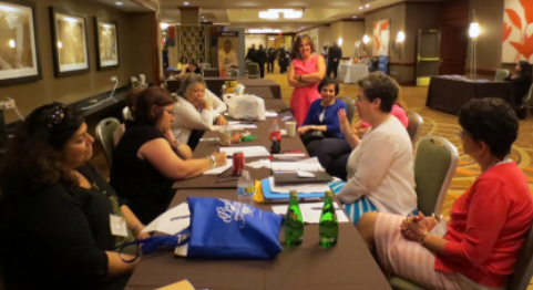 Boston, MA: Dianne (white shirt) leads her first meeting as President of Antiochian Women in July, 2015