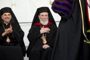 Bp. Alexander applauds as Bp. Basil receives honorary doctorate