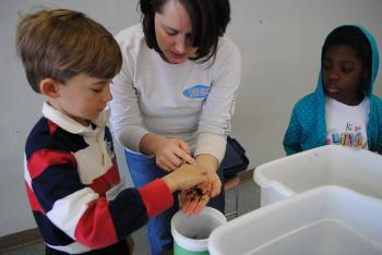 Tatiana Jacobs, Education Director, teaches children about worm-composting