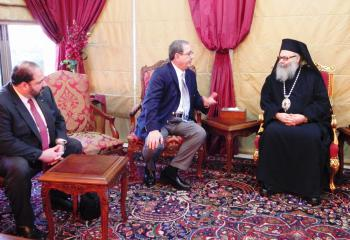 IOCC's Executive Director and Board Chair with Patriarch John X (Photo: George Antoun/IOCC)