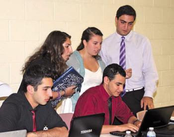 Teens working at the 2012 Teen SOYO Leadership Training